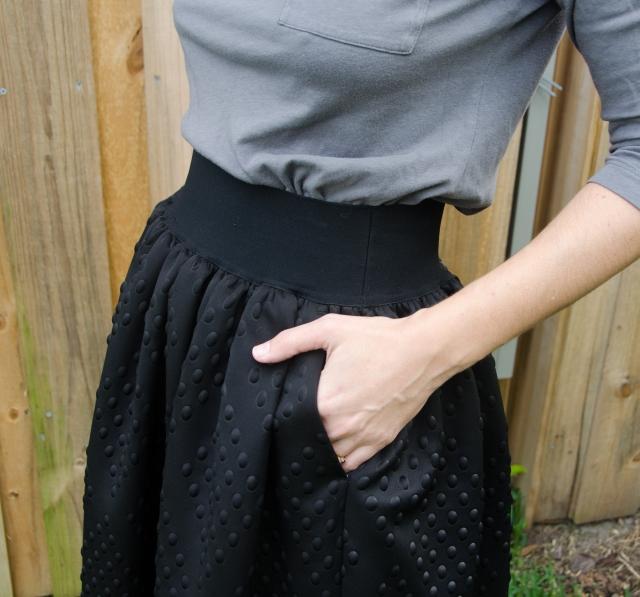 black skirt pockets
