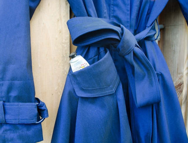 blue trench with hand lotion